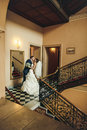 Groom and bride hugging and kissing on the  background corridor Royalty Free Stock Photo
