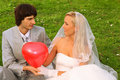 Groom and bride keep red balloon heart Royalty Free Stock Photos