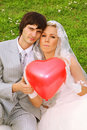 Groom and bride keep red balloon heart Royalty Free Stock Photography