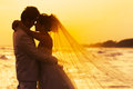 Groom and bride in love emotion romantic moment on the beach Stock Images