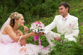 The groom and the bride on nature in white suit in a pink dress Royalty Free Stock Photos