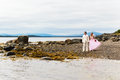 The groom and the bride on nature in white suit in a pink dress Royalty Free Stock Photography