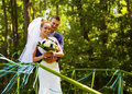 Groom and bride near handrail on nature Royalty Free Stock Photo