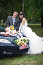 Groom with the bride near the wedding car Royalty Free Stock Photo