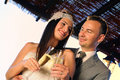 Groom and bride toasting on a terrace smiling eye contact Royalty Free Stock Photo