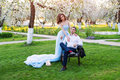 Groom and bride together, wedding couple. Young couple embracing in blooming spring garden. Love and romantic theme. Royalty Free Stock Photo