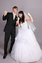 Groom and bride are very happy in studio Royalty Free Stock Images