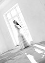 Groom and bride young pretty on the empty room black white Royalty Free Stock Photo