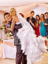 Groom carries bride on his hands at wedding Stock Photography