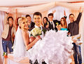 Groom carries bride on his hands at wedding Royalty Free Stock Images