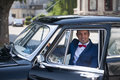 Groom at civil wedding photo session handsome groome in a vintage car Royalty Free Stock Images