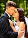 Groom embrace bride happy outdoor Royalty Free Stock Image