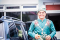 Groom exit from car newly wedded malay vehicle Royalty Free Stock Photography