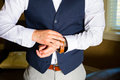 Groom getting ready a fastens his watch on his wrist while for a wedding day celebration Stock Image