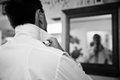 Groom getting ready a young man for his wedding looking in mirror Royalty Free Stock Image