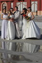 Groom and girls four young in wedding dresses Royalty Free Stock Image