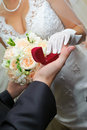 Groom gives to bride a gold ring Royalty Free Stock Photo