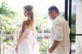 Groom helps the bride to wear a wedding dress Royalty Free Stock Photo