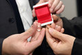 Groom and his witness carrying a wedding ring closeup the Stock Image