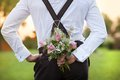 Groom holding wedding bouquet part of the in hand Royalty Free Stock Images