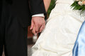 Groom holds the bride by the hand closeup Royalty Free Stock Photo