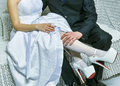Groom holds bride s leg in white stocking Royalty Free Stock Photography