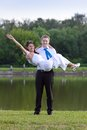 The groom holds his bride in his Royalty Free Stock Image