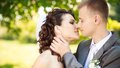 The groom kisses the bride Royalty Free Stock Photo