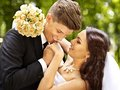 Groom kissing bride outdoor Stock Image