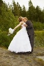 Groom passionately kisses bride Royalty Free Stock Images
