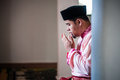 The groom praying a malay performing a prayer after solemnization Royalty Free Stock Images