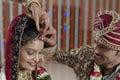 Groom putting Sindoor on Bride's forehead in Indian Hindu wedding. Royalty Free Stock Photo