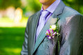 Groom s buttonhole closeup with delicate purple flowers Royalty Free Stock Image