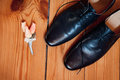 Groom set clothes. Wedding rings, shoes, and bow tie Royalty Free Stock Photo