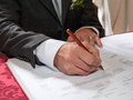 Groom sign wedding contract signing in church Stock Photos