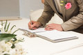 Groom signing marriage license or wedding contract Stock Photos