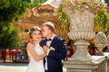 Groom touching bride near carousel in park Royalty Free Stock Photo