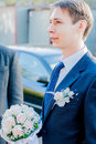 Groom waiting for the bride standing with her bouquet Royalty Free Stock Photo
