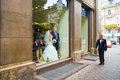The groom is walking beside the showcase with bride she standing there like mannequin Royalty Free Stock Image