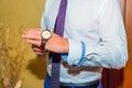 Groom wear watch on hand