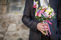 Groom with wedding bouquet selective focus on copy space Royalty Free Stock Images