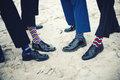 Groomsmen and groom s feet with funny socks Royalty Free Stock Photography