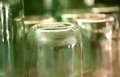 Grooved bottom of glass jar blurred background Stock Images