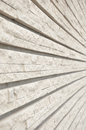 Grooved decorative stone wall texture diminishing perspective Stock Photo