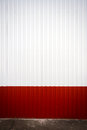 Grooved metal wall red and white industrial Stock Images