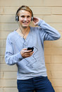 Groovy tunes young male listening to music on phone Stock Images