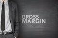 Gross margin on blackboard black with businessman Royalty Free Stock Images