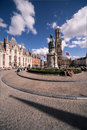 Grote markt bruges the city center square statue and historic belfry in the medieval old town of brugge belgium Royalty Free Stock Photos