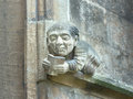 Grotesque on an exterior wall at balliol college oxford university england a stone of an academic reading a book Stock Images