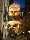 Grotesque masks in window shop florence italy Stock Image